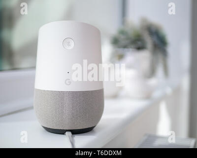 mute button on back of smart home speaker device and microphone hole - Stock Photo