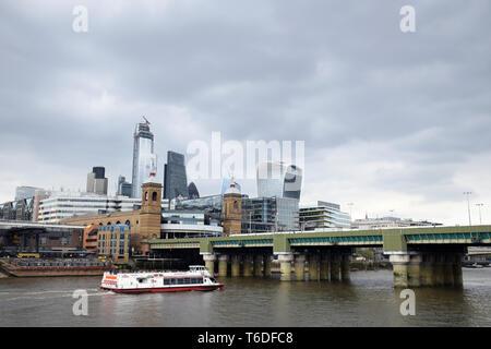 London City skyline, April 2019 UK. Cannon Street railway bridge in foreground - Stock Photo