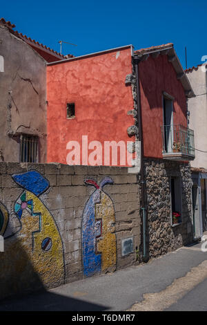 Orgosolo a village in the province of Nuoro, in Sardinia, Italy, famous for its collection of street murals with  a rich variety of themes from  villa - Stock Photo