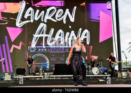 Indio, California, April 28, 2019,  Lauren Alaina on stage performing to an energetic crowd on day 3 of the Stage Coach Country Music Festival. Photo: - Stock Photo