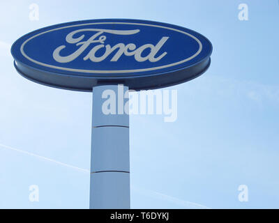 FORD presentation against the blue sky. Ford is a representative of the American auto brand. - Stock Photo