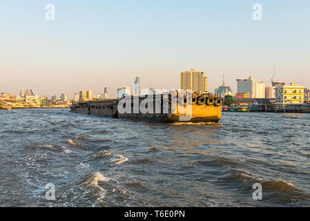 Pusher with barges on the Chao Phraya river in Bangkok - Stock Photo