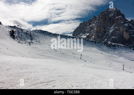 ski slope with mountain in background, in the Italian Dolomites - Stock Photo