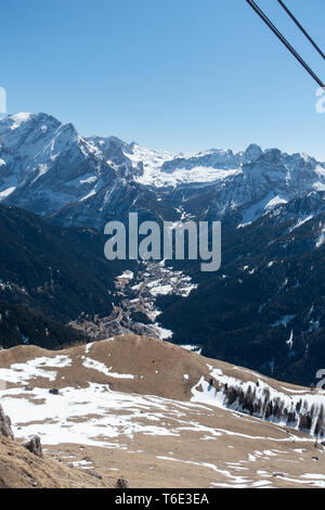 View of the dolomites mountains from a cable car ascending to the ski slopes - Stock Photo