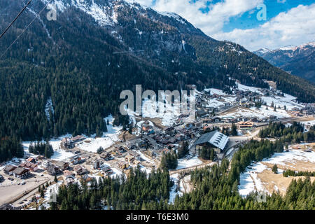 Returning to the ski village in a cable car - Stock Photo
