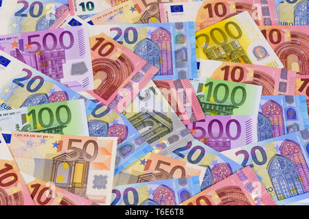 group of many Euro banknotes laying on table - Stock Photo