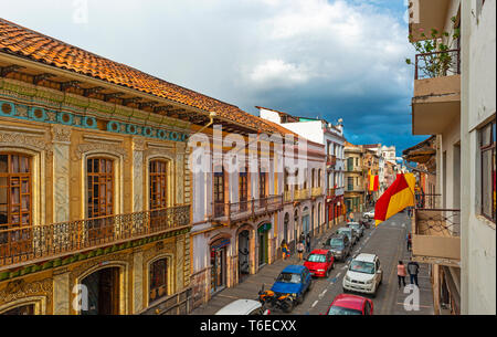 Sunset in the city center of Cuenca with its colonial style facades and a thunder storm on the way, Ecuador. - Stock Photo