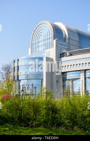 Eastern facade of the Paul-Henri Spaak building, seat of the hemicycle of the European Parliament in Brussels, Belgium, seen from the Leopold park. - Stock Photo