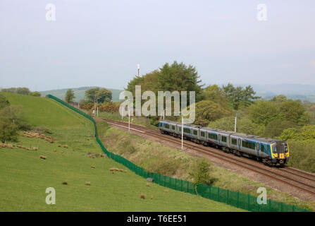 Class 350 Siemens Desiro emu train 350 405 operated by TransPennine Express passing Grayrigg in Cumbria on the West Coast Mainline on 30th April 2019. - Stock Photo