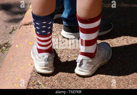A young man wears a pair of patriotic stars and stripes socks in Santa Fe, New Mexico USA - Stock Photo
