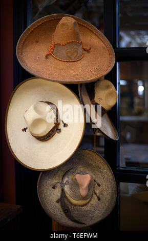 Vintage Mexican sombreros for sale at a shop in Santa Fe, New Mexico USA - Stock Photo
