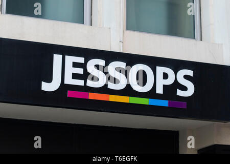 A close-up of a Jessops camera store sign on March 17, 2019 in Cardiff, United Kingdom. - Stock Photo