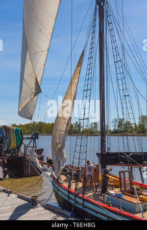 Trimming sails of the sailing vessel Providence before the first charter voyage of the 2019 season - Stock Photo