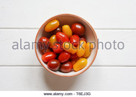 heirloom cherry tomatoes in bowl - Stock Photo