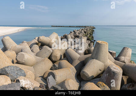 Breakwater of tetrapots at Helgoland island in German North sea - Stock Photo
