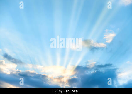 Sun rays shining through cloud - Stock Photo