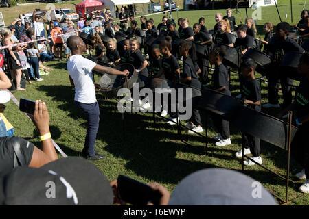 Amanzimtoti, KwaZulu-Natal, South Africa, people, conductor leading performance of Warner Beach Prep School steel drum band, 56th Highland Gathering - Stock Photo