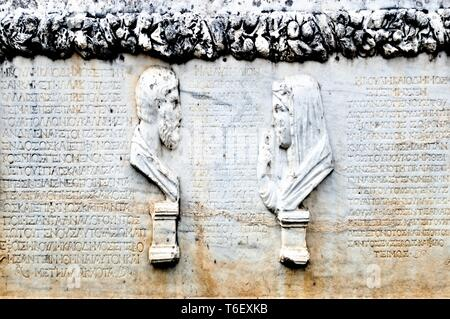 Ancient Greek text inscriptions on a large fragment of stone