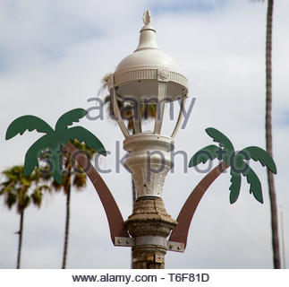 White Lamppost with Palm Tree Design - Stock Photo