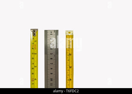 Tape measure, stainless steel ruler and dressmakers tape measure, isolated on a white background. Different industries, measurements concepts - Stock Photo