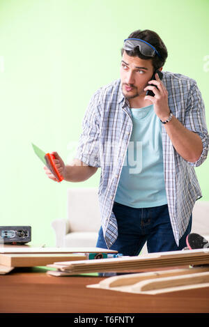 Woodworker working in his workshop - Stock Photo