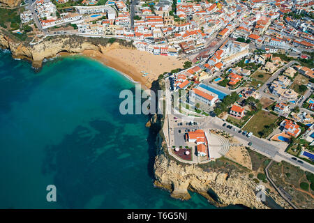 PICTURESQUE CITY OF CARVOEIRO AND ITS SANDY BEACH (aerial  view). Algarve, Portugal. - Stock Photo