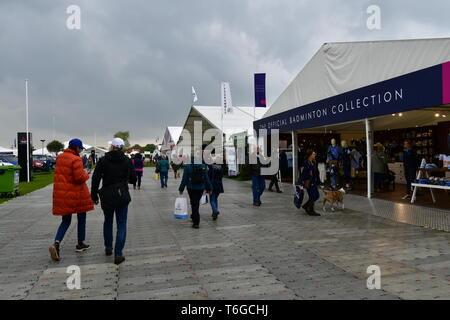 Badminton, Gloucestershire, UK. 1st May 2019. UK Weather: On a wet and damp afternoon visitors seen walking between trade stands at the 70th Anniversary of The Mitsubishi Motors Badminton Horse Trials.Picture Credit: Robert Timoney/Alamy Live News - Stock Photo