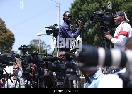 Nairobi, Kenya. 1st May, 2019. Members of the media seen covering during the celebrations.Kenyans celebrated Labour Day at Uhuru Park in Nairobi where some Youths protested against rampant corruption and poor leadership in Kenya. Unemployment and underemployment is widespread in the country. Credit: Billy Mutai/SOPA Images/ZUMA Wire/Alamy Live News - Stock Photo