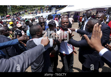 Nairobi, Kenya. 1st May, 2019. Youths seen protesting during the celebrations.Kenyans celebrated Labour Day at Uhuru Park in Nairobi where some Youths protested against rampant corruption and poor leadership in Kenya. Unemployment and underemployment is widespread in the country. Credit: Billy Mutai/SOPA Images/ZUMA Wire/Alamy Live News - Stock Photo