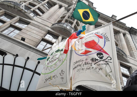 London, UK. 1st May 2019. Carn-evil of Chaos with Samba drums demonstration  for climate change at embassy of Brazil, London, UK. 1st May 2019. Credit: Picture Capital/Alamy Live News - Stock Photo