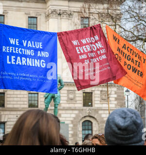 London, UK, 1st May 2019. Protesters in Parliament Square cheer on speakers with placards, banners and posters. The event is organised by Extinction Rebellion against Climate Change. Credit: Imageplotter/Alamy Live News - Stock Photo