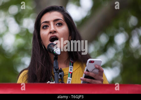 London, UK. 1st May, 2019. Aliya Yule of Labour For A Green New Deal addresses climate protesters at a Declare A Climate Emergency Now demonstration in Parliament Square organised to coincide with a motion in the House of Commons to declare an environment and climate emergency tabled by Leader of the Opposition Jeremy Corbyn. The motion, which does not legally compel the Government to act, was passed without a vote. Credit: Mark Kerrison/Alamy Live News - Stock Photo