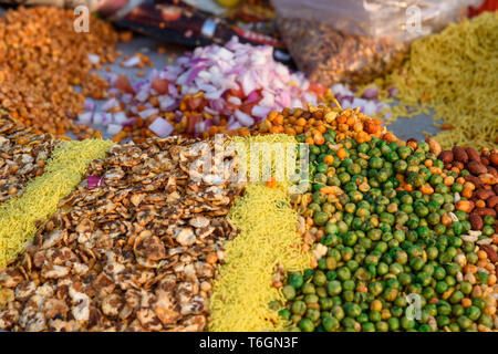 Indian street snack Chana Chor, fried seeds and peas in Jaipur. India - Stock Photo