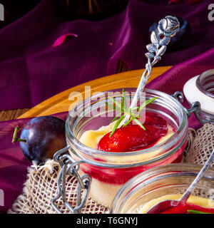 for breakfast fresh semolina pudding with cinnamon and plums - Stock Photo