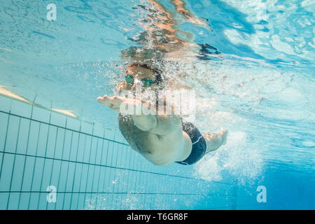 Male swimmer in the swimming pool.Underwater photo with copy space. - Stock Photo