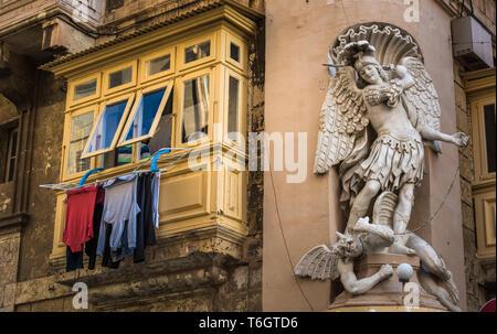Street of Valletta with traditional balconies, Malta - Stock Photo