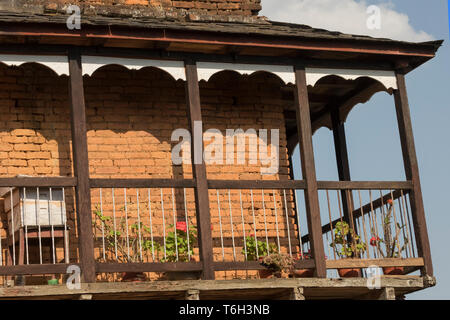 A traditional house Balcony located in the main street of Bandipur in the midday and small balcony wooden steps for passing upstair. Nepal - Stock Photo