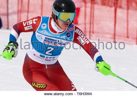 MOROZNAYA MOUNTAIN, KAMCHATKA, RUSSIA - MAR 28, 2019: Russian Alpine Skiing Cup, International Ski Federation Championship slalom. Skier Ovchinnikov A - Stock Photo