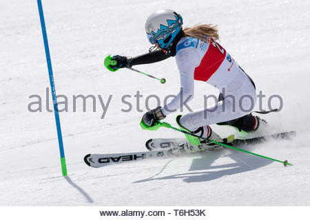 MOROZNAYA MOUNTAIN, KAMCHATKA, RUSSIA - MAR 29, 2019: Russian Alpine Skiing Cup, International, Ski Federation Championship, slalom. Mountain skier Gu - Stock Photo