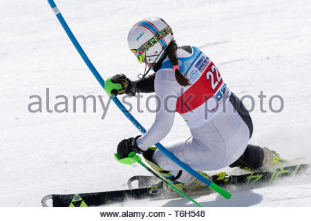 MOROZNAYA MOUNTAIN, KAMCHATKA, RUSSIA - MAR 29, 2019: Russian Alpine Skiing Cup, International Ski Federation Championship slalom. Mount skier Ekateri - Stock Photo