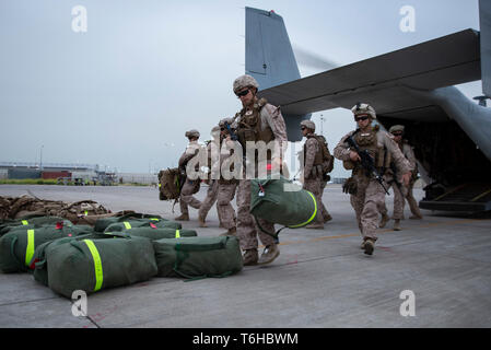 U.S. Marines with Counter-Unmanned Aerial Systems Detachment, 2nd Low Altitude Air Defense Battalion, attached to Special Purpose Marine Air Ground Task Force Crisis Response-Central Command, unload gear after arriving in Southwest Asia, April 15, 2019. 2nd LAAD Battalion provides close in, low altitude, surface-to-air weapons fires in defense of forward combat areas and installations in the Central Command area of operations. (U.S. Marine Corps photo by Cpl. Alina Thackray) Stock Photo