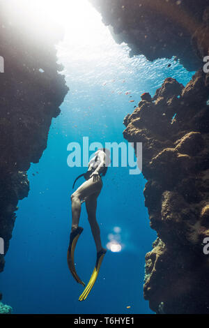 Amazing girl freediving in famous Bells, Egypt - Stock Photo