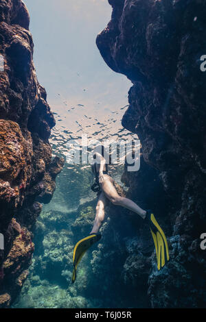 Young asian woman freediving in the Bells - Stock Photo