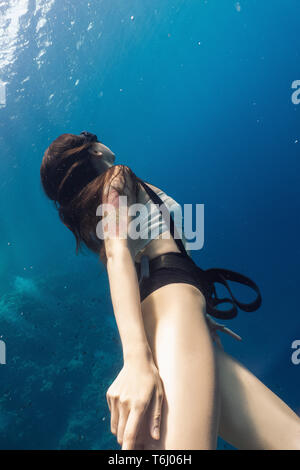 Young woman freediver portrait underwater - Stock Photo