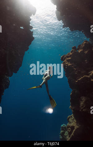 Asian woman freediving in famous Bells, Egypt - Stock Photo