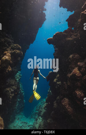 Asian woman freediver in famous Bells, Egypt - Stock Photo