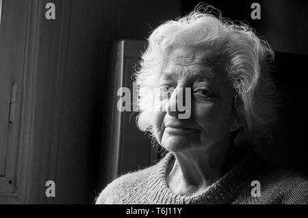 Portrait of old woman looking at the camera. Close view. - Stock Photo