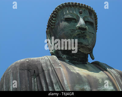 The Great Buddha (Daibutsu) on the grounds of Kotokuin Temple in Kamakura, Japan. - Stock Photo