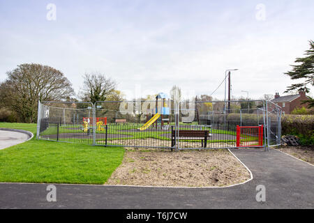 Closed and temporary fenced of new children playground in Cheshire UK - Stock Photo