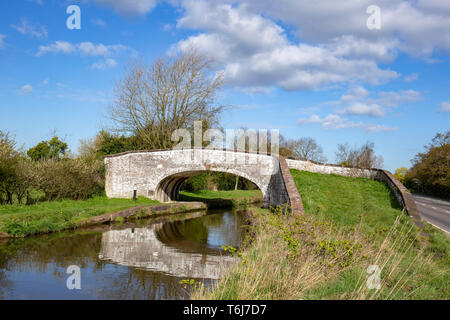 Arch bridge over Trent and Mersey Canal between Sandbach and Middlewich in Cheshire UK - Stock Photo